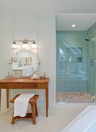 bathroom gorgeous round mirror plus wall sconce and custom makeup
