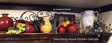 kitchen decor above cabinets tuscan decorating above kitchen
