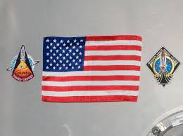 file sts 135 harmony s hatch with u s flag closeup cropped