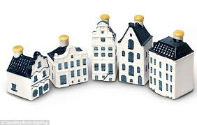 10 orphan row houses so lonely you ll want to take them klm passengers given delft blue miniature replica houses filled with