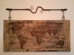 wood burned world map on reclaimed wood deer park