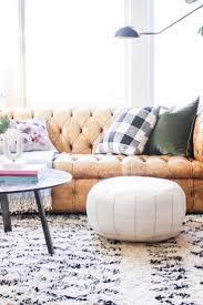 leather tufted sofa moroccan rug white ottoman buffalo check