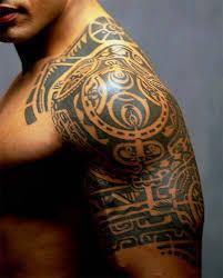 tribal maori tattoo on left arm