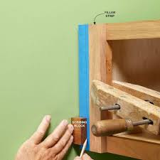 install cabinets like a pro the family handyman how to install cabinets like a pro woods kitchens and kitchen