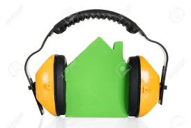 Raw House Model Green House Model With Headphone Over White Background Stock Photo