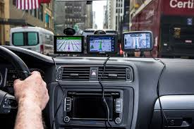 wheels car navigation systems plot a course forward against phone