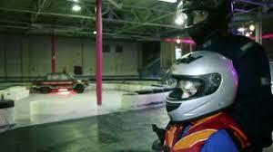 Helmet Chair Little Boy In Helmet And Racer Suit Sits In Cart Chair Stock Video