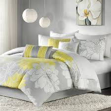brighten up your bedroom with this cheerful madison park brianna seven piece comforter set this charming fl comforter set pairs hues of gray