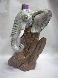 ceramic elephant head from wood sculpture