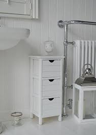 White Freestanding Bathroom Cabinet by Shutter Slim Freestanding Bathroom Cabinet With 4 Drawers Beside