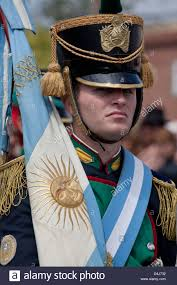 Argentine Flag Soldier In Traditional Uniform With Argentine Flag On Parade In