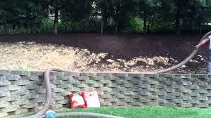 how to mulch a steep hill youtube
