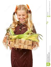 thanksgiving indian costume thanksgiving indian with corn in basket stock photo image