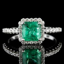 emerald jewelry rings images Colombian emerald with fishtail set diamond halo 18k white gold jpg
