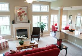 the living room and kitchen of the mccormick ii floor plan by ball