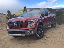 truck nissan titan watch the 2017 nissan titan half ton pro 4x tackle the cliffhanger
