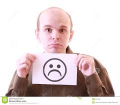 unhappy young unhappy man with unhappy smile royalty free stock images