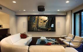living room living room theater with recessed lighting and wall
