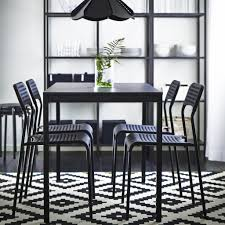 ikea black brown dining table dramatic dynamic black and white