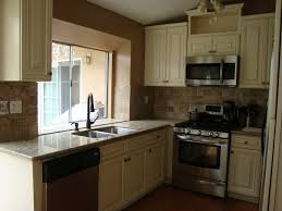 pictures of kitchens with antique white cabinets antique white cabinets u0026 venetian gold granite counter tops