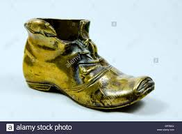 brass boot and mice ornament stock photo royalty free image