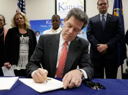 kansas restricts welfare money bans tattoo lingerie spending time