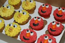 pink little cake elmo big bird and cookie monster cupcakes