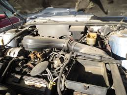 rattletrap jeep engine junkyard find 1988 cadillac coupe de ville gt the truth about cars