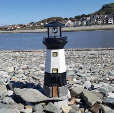 solar powered lighthouse rotating led garden light house