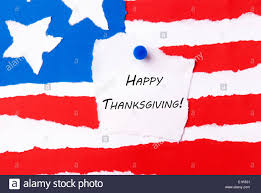 happy thanksgiving note on an american flag background stock photo