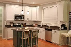 kitchen cabinets next to window interior design