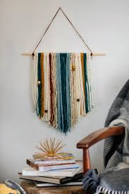 how to make an easy diy yarn wall hanging hgtv