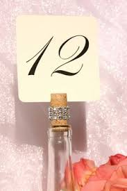 gold wine bottle table numbers gold wine bottle table numbers woodland wine pairing wedding