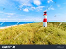 ellenbogen lighthouse on sand dune against stock photo 608784728