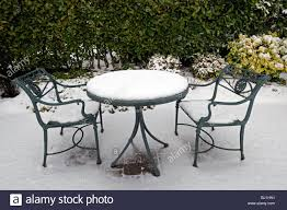 Patio Furniture Covers For Winter - rustic wrought iron garden seat table cover covered with snow
