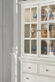how to arrange dishes in china cabinet how to set up a china cabinet in 6 easy steps overstock