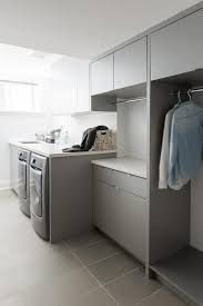 contemporary laundry room cabinets white and gray laundry room with green accents contemporary