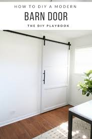 How To Make Barn Doors by How To Build And Hang A Diy Barn Door On A Budget In Your Home