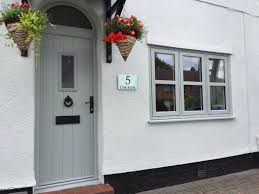residence 9 windows and a solidor front door in painswick house