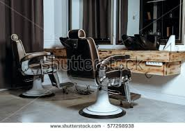 stylish vintage barber chair wooden interior stock photo 569076817