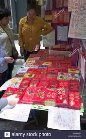 luck envelopes dh wing kut sheung wan hong kong asian woman buying luck