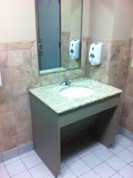 commercial bathroom remodeling in austin roll under vanity with lift out panel for protection from pipes