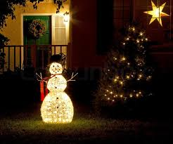 decorations snowman and tree with lights on