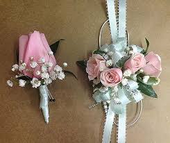 pink corsage light blue and pink corsage and boutonniere set in smyrna ga