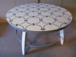 large round coffee table after upcycled with new paint and a
