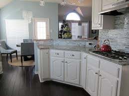 Engineered Hardwood In Kitchen Glass Tile Kitchen Backsplash And Handscraped Engineered Hardwood