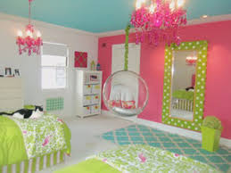 girls pink and green bedding white pink wall connected by green bedding bed and white wooden