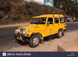 jeep car mahindra india meghalaya shillong local transport yellow mahindra jeep
