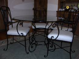 dark wrought iron dining room sets on large light blue rug brown
