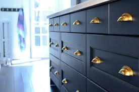 blue kitchen cabinets with copper hardware 32 kitchen cabinet hardware ideas sebring design build